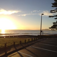 Photo taken at Mairangi Bay Beach by Marty K. on 3/21/2012