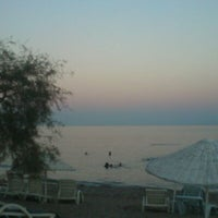 Photo taken at Ünlüselek Beach by Muharrem A. on 8/26/2012