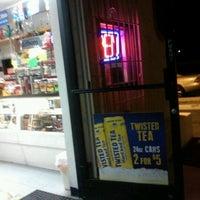 Photo taken at Sam's Liquor & Smoke Shop by Angelz L. on 2/27/2012
