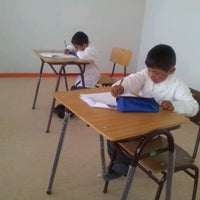 Photo taken at Colegio Simón Bolívar by Katherine R. on 4/16/2012