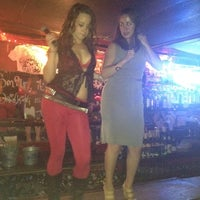 Photo taken at Coyote Ugly Saloon by Travis B. on 6/24/2012