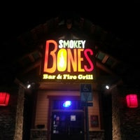 Photo taken at Smokey Bones Bar & Fire Grill by Angela S. on 8/18/2012