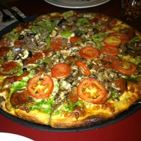 Photo taken at Moose's Tooth Pub & Pizzeria by Matt H. on 8/27/2012