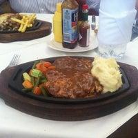 Photo taken at Bull Steak House by Farhan K. on 6/30/2012