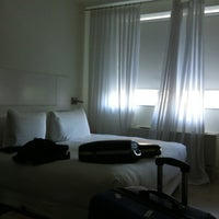 Photo taken at NU Hotel by Ed C. on 7/21/2012
