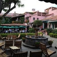 Photo taken at Las Mañanitas Hotel, Garden, Restaurant & Spa by Barbara on 8/26/2012