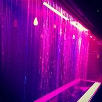 Photo taken at Status Lounge by Amanda V. on 5/13/2012