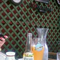 Photo taken at Genesis Bar & Restaurant by Will R. on 5/30/2011