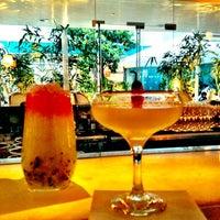Photo taken at Long Bar by Gela K. on 6/20/2012