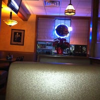 Photo taken at Joe Santucci's Square Pizza Bar and Grill by Bill B. on 12/23/2011