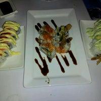 Photo taken at Azukar Lounge by Fernando on 3/14/2012
