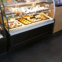 Photo taken at Tin Roof Bakery by Dean S. on 8/24/2012