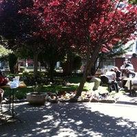 Photo taken at Crossroads Café by Gabriela on 4/15/2012