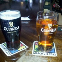 Photo taken at Mick Kelly's Irish Pub by Erica K. on 3/5/2012