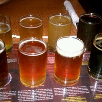Photo taken at Oggi's Pizza & Brewing Company by martha j. on 7/25/2011