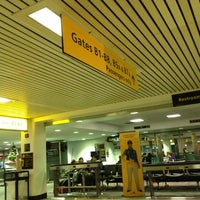 Photo taken at Gate B4 by Christopher M. on 12/24/2011