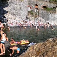 Photo taken at Spiaggia di Riomaggiore by Jeff W. on 9/17/2011