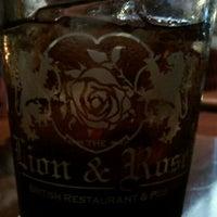 Photo taken at The Lion & Rose British Restaurant & Pub by Elizabeth D. on 10/6/2011