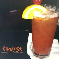 Photo taken at Twist Restaurant & Tapas Bar by Fannie H. on 5/19/2012