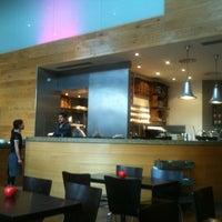 Photo taken at Gourmet Burger Kitchen by R Sandika M. on 8/24/2011