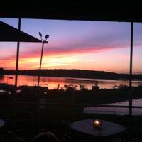 Photo taken at Rick's Cafe Boatyard by Brandon M. on 6/17/2011