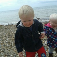 Photo taken at West Beach Selsey by Ewan G. on 8/8/2012