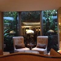 Photo taken at TheAthenaeum Hotel by Megan L. on 4/17/2012