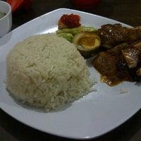 Photo taken at J&J chicken rice by Vivi D. on 12/14/2011
