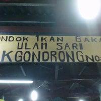 Photo taken at Perkampungan Nelayan Muara Angke by joe s. on 8/20/2012