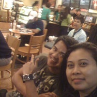 Photo taken at Starbucks Coffee by Joan M. on 10/27/2011