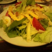 Photo taken at Wings by Alfonso R. on 7/23/2012