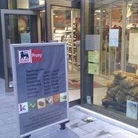 Photo taken at Proxy Delhaize by Maarten B. on 12/23/2011