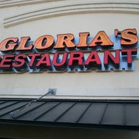 Photo taken at Gloria's by Christopher S. on 3/23/2011