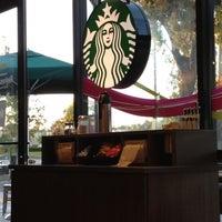 Photo taken at Starbucks by Nikos A. on 8/3/2012