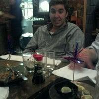 Photo taken at Papaya Thai & Asian BBQ by Sarah S. on 1/8/2012