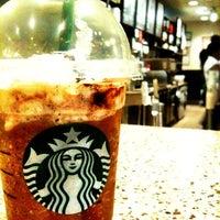 Photo taken at Starbucks by Sergio V. on 4/8/2011