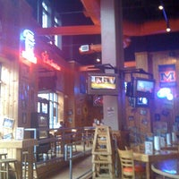 Photo taken at Hooters by Hannah B. on 3/20/2012