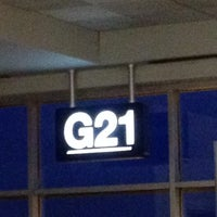 Photo taken at Gate G21 by Gracie J. on 5/6/2012
