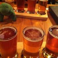 Photo taken at The Noble Pig Brewhouse & Restaurant by Carey E. on 12/22/2011