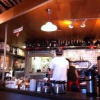 Photo taken at Ula Cafe by Liz J. on 4/14/2011