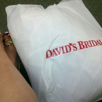 Photo taken at David's Bridal by Myrna Z. on 7/6/2011