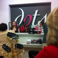 Photo taken at Dots Fashions by Janice on 12/15/2011