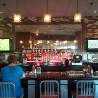Photo taken at Grind Burger Bar & Lounge by Pat H. on 8/11/2012