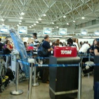 Photo taken at Check-in LATAM by Mariel P. on 12/23/2011