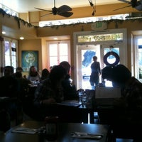 Photo taken at Barefoot Café by Lisa C. on 12/27/2011
