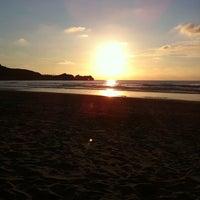 Photo taken at Playa de Salinas / San Juan de Nieva by Nuria F. on 7/23/2011