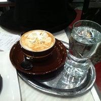 Photo taken at Cafè Melange by Melih A. on 2/2/2011