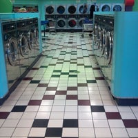 Photo taken at Bubbleland Laundromat by Jackelynne Y. on 2/24/2012