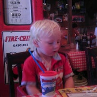 Photo taken at Famous Dave's by Jerry G. on 7/4/2012