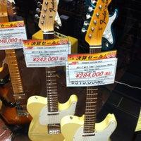 Photo taken at Yamano Music Ginza by Masashi S. on 3/2/2012